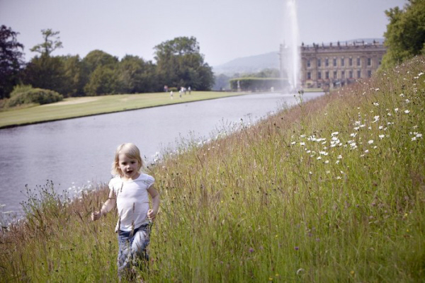 girl running by chatsworth estate & house