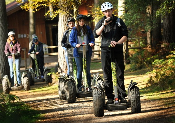 People on go ape segways in the forest