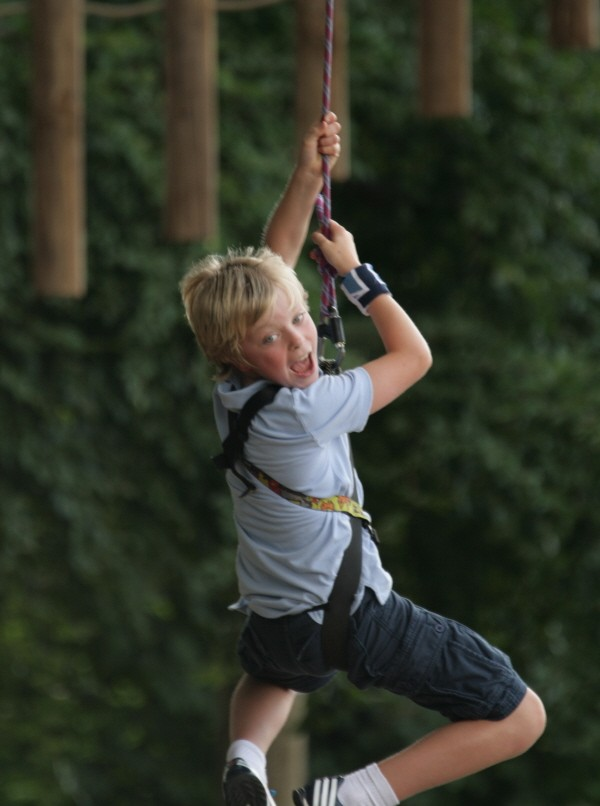 boy on aerial extreme rope course