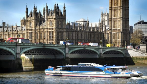 Thames Clipper along the River Thames by Houses of Parliament